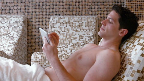 Man relaxing in the thermo suite Live Action
