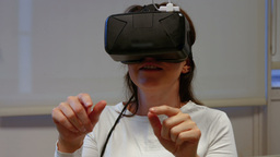 Woman using oculus rift in college Live Action