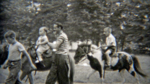 1949: Baby's first horse ride with dad holding for safety Footage