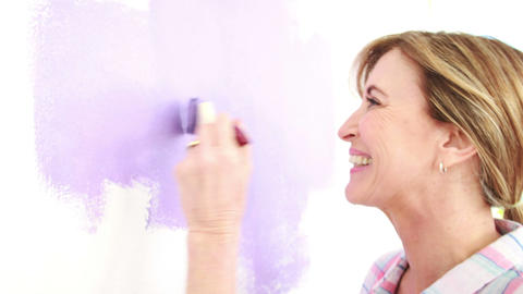 Happy woman painting the wall Footage