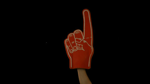 Supporter waving foam finger Live Action