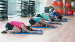 Yoga class in childs pose in fitness studio Footage