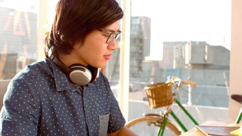 Happy hipster working on computer Live Action