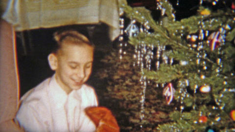1954: Happy boy gets baseball glove for Christmas gift Footage