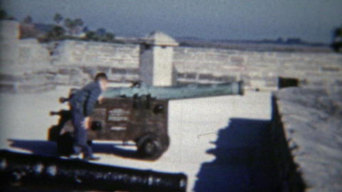 1959: Child playing with cannons at old military fort museum Footage