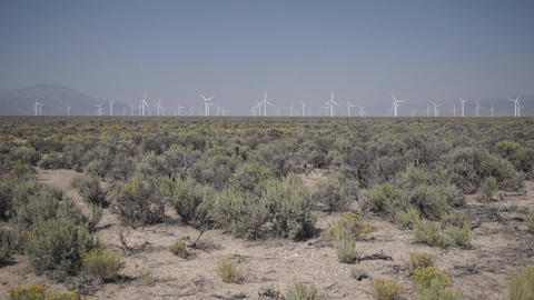 Pan Right of a Windfarm in the Desert Footage