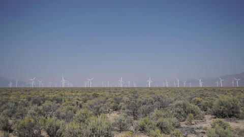 Pan Down of a windfarm in the desert Footage