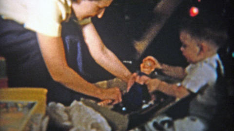 1953: Howdy Doody acrobat toy charms a child's Christmas Footage