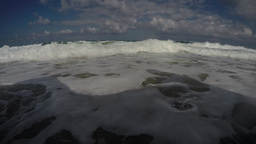Waves rolling to the shore towards the camera, low angle in 2.7K Footage