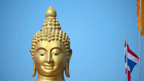 Buddha gold statue on blue sky background Footage