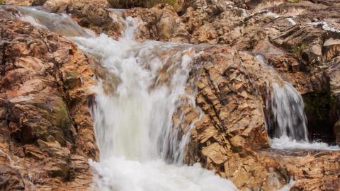 closeup cascade of stormy foamy waterfalls in park Footage