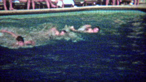 1962: Kid swimming race across luxury hotel pool and diving board Footage
