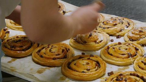 german bakery spread liquid sugar on a pastery roll 11714 Footage