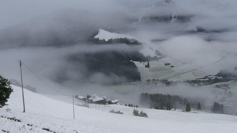 pan over foggy and snowy dolomites prags valley 4k 11715 Footage
