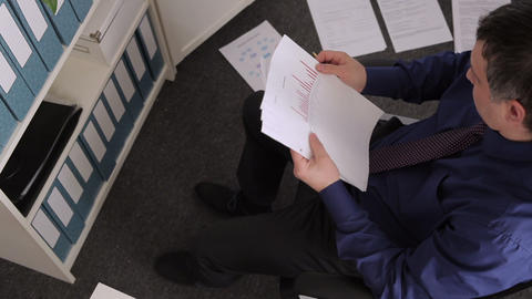 Businessman Working with the Documents and Crumpling Paper Footage