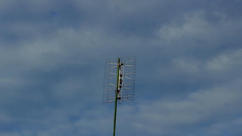 Aerial Antenna On A Cloudy Blue Sky Background - Time Lapse stock footage
