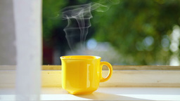 Yellow Cup of Coffee on the Windowsill Footage