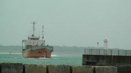 Port in Okinawa Islands 31 cargo ship approaching Footage