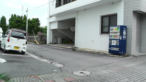 Rural Japanese Town in Okinawa Islands 15 car hand Stock Video Footage