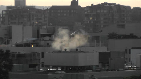 Steam over Rooftops 01 dawn Stock Video Footage