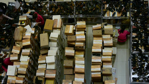 Many shoe box,salesman,People choose shoes at... Stock Video Footage