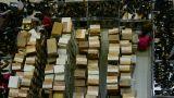 Many shoe box,salesman,People choose shoes at stall,Various varieties of styles Footage