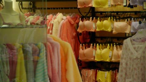 Many of bra,pajamas in Lingerie shop Stock Video Footage