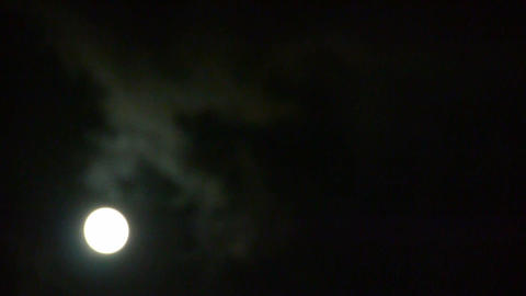 Full moon through cloudy,night flight over clouds and... Stock Video Footage