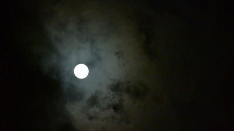 Full moon at cloudy sky,night flight over clouds Stock Video Footage