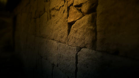 nostalgic stone wall with golden lights at night Stock Video Footage