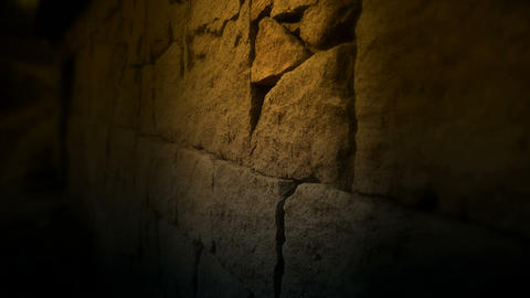 nostalgic stone wall with golden lights at night Footage