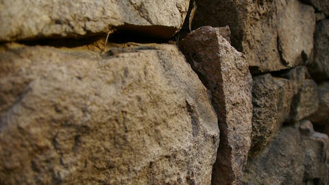 stone wall and winding lane in mountain,travelers back Stock Video Footage