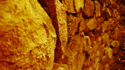 shine golden sunlight on stone wall in mountain Stock Video Footage