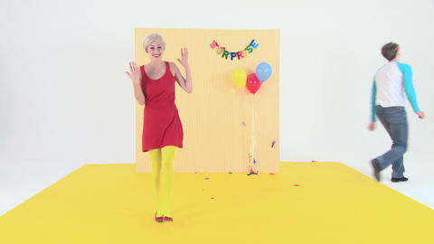 Young woman standing, friends run and pop balloons, time... Stock Video Footage