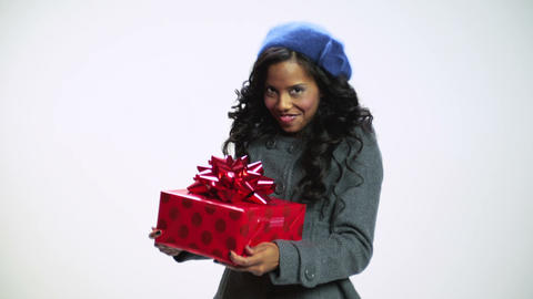 Young woman holding christmas gift and dancing Stock Video Footage