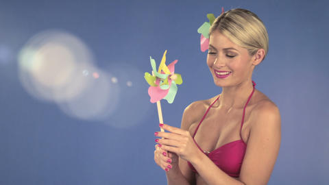 Young woman with a pinwheel Stock Video Footage
