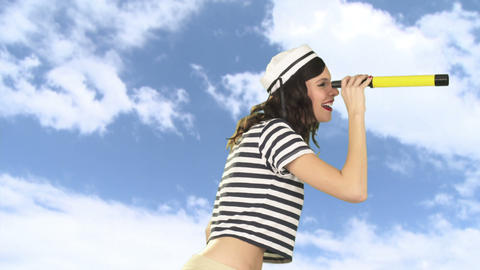 Young woman with telescope, pointing and smiling Stock Video Footage