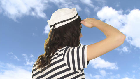 Young woman in sailor hat looking away Stock Video Footage