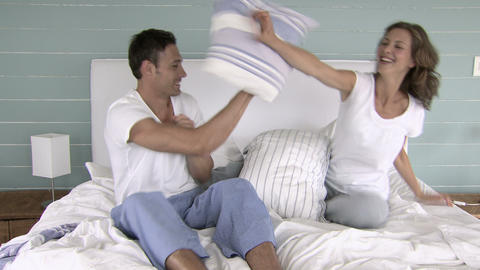 Couple having a pillow fight Stock Video Footage