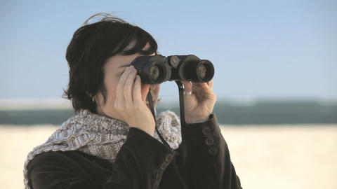 Woman using binoculars Stock Video Footage