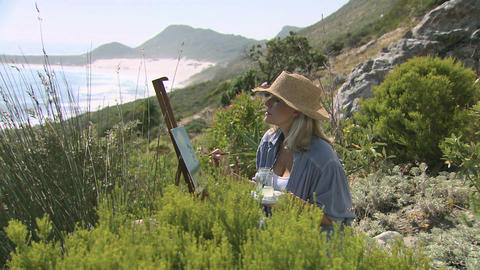 Artist painting on hillside Stock Video Footage