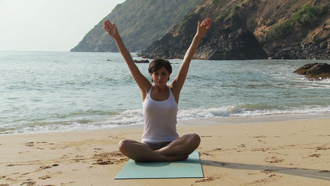 Woman practicing yoga by the ocean Stock Video Footage