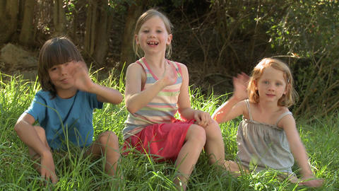 Children waving at camera Stock Video Footage