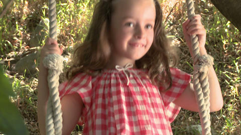 Girl on a swing Stock Video Footage
