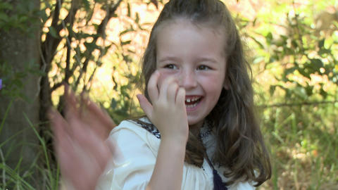 Boy putting flower on face and making girl laugh Stock Video Footage