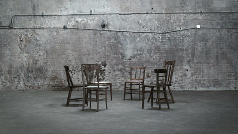 Empty chairs in a warehouse, zoom in Stock Video Footage