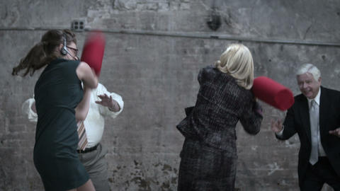 Two women fighting with pugil sticks Stock Video Footage