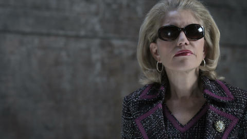 Serious businesswoman wearing sunglasses Stock Video Footage