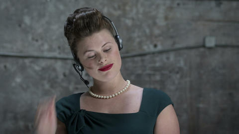Woman using telephone headset Stock Video Footage