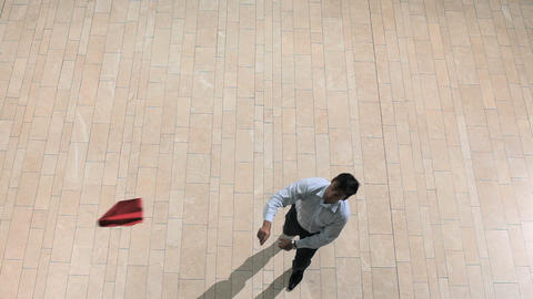 Businessman throwing paper airplane, overhead view Stock Video Footage